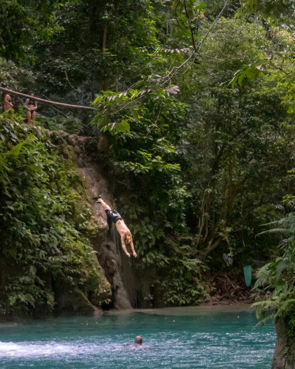 Cliff divers at Kawasan Falls, Cebu City, The Philippines