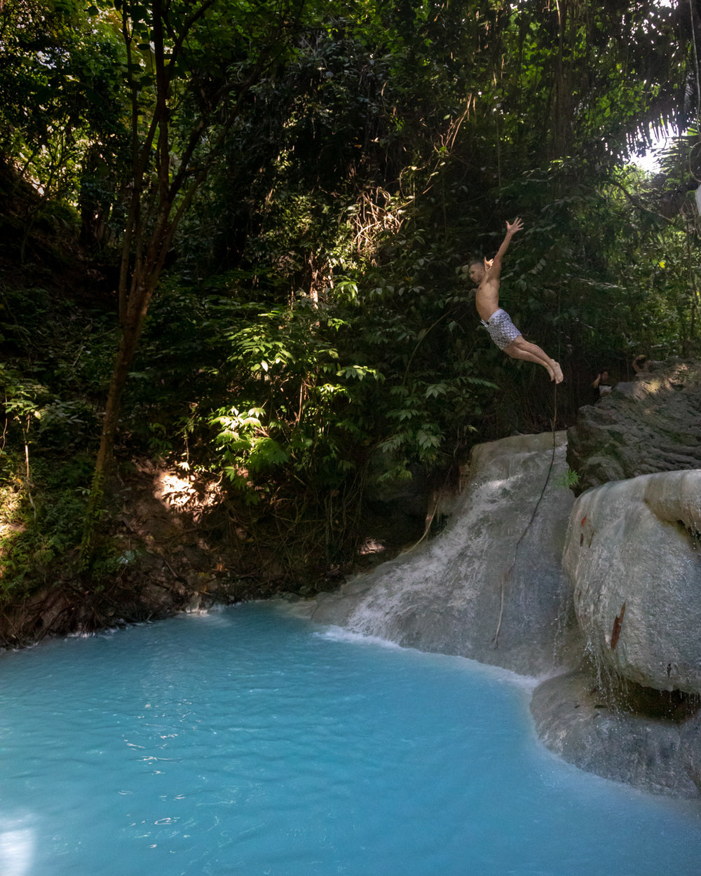 Cliff diving at Aguinid Falls, Cebu