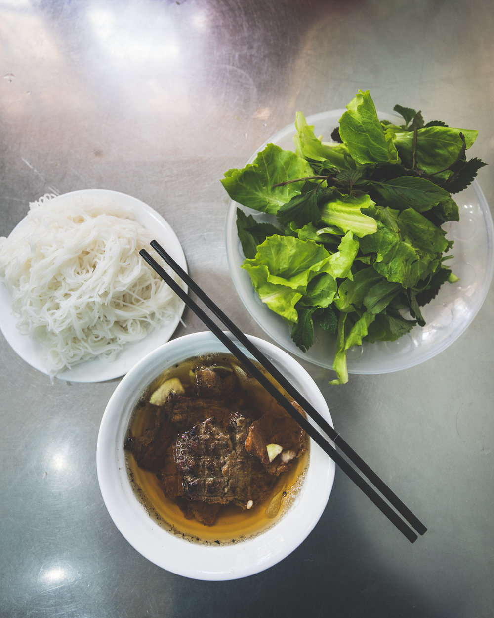 Bun Cha - a delicious dish that blends sweet and sour broth with the smokey bbq pork patties.