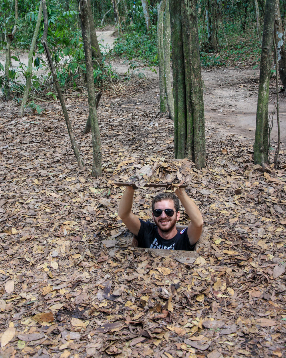 Demonstrating just how small those tunnels were for the Viet Cong!