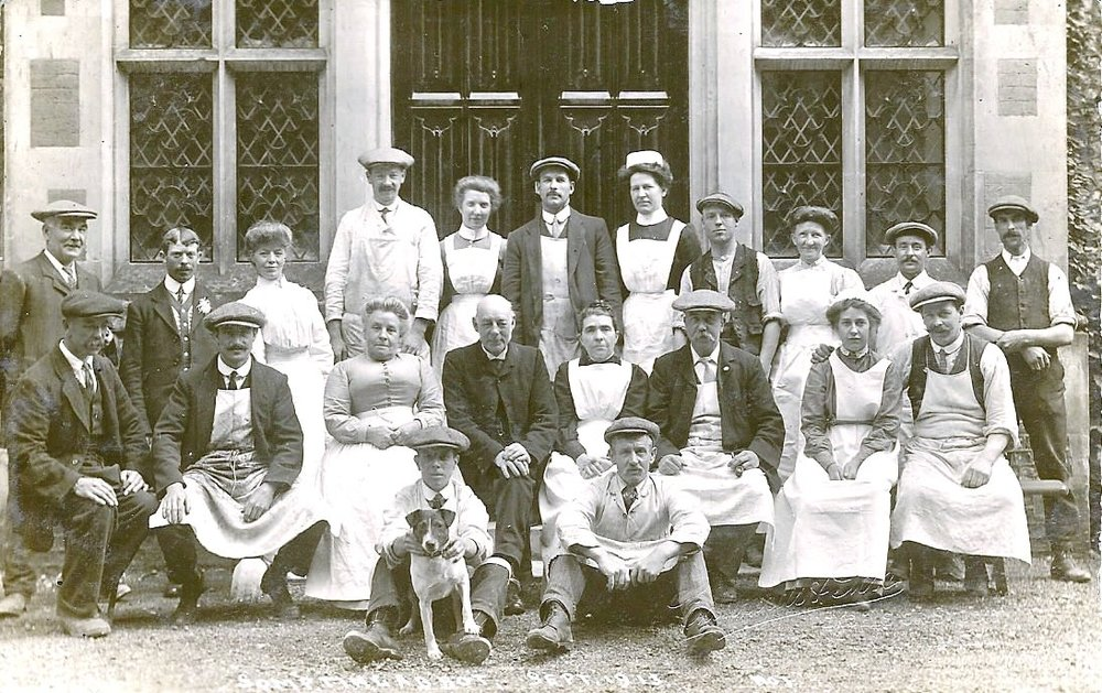 Staff at Sompting Abbotts - Do you recognise the immense entrance doors to the school? They've changed little since 1856.This picture, thought to date from 1913, shows the household staff. Like most manor houses of the time, Sompting Abbotts had an extensive staff. Photo credit: www.lancing-sompting-pastfinders.org.uk