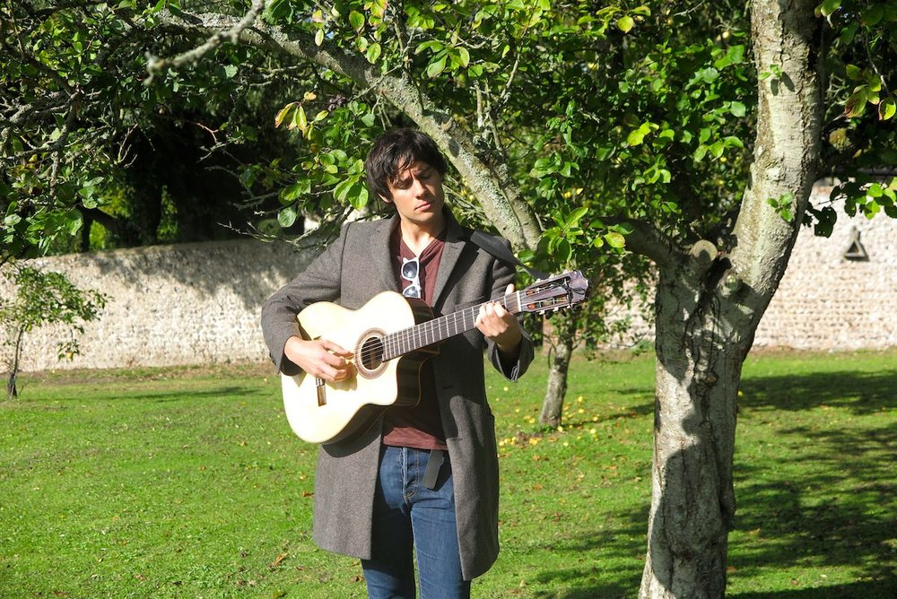 Ned, back in the Pre-Prep Walled Garden that was the memory spark for his haunting and uplifting song,  The Orchard . Ned dedicated the song to the late Tim Sinclair, headmaster of Sompting Abbotts, who taught him during his years at the school.
