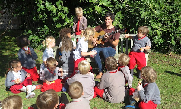 Ned returned to Sompting Abbotts Preparatory School to sing  The Orchard  to the children in the Pre-Prep in the Walled Garden where he himself played under the apple trees as a child. It was a beautiful sunny Autumn day and the grass was dotted with a windfall of golden apples from the trees.