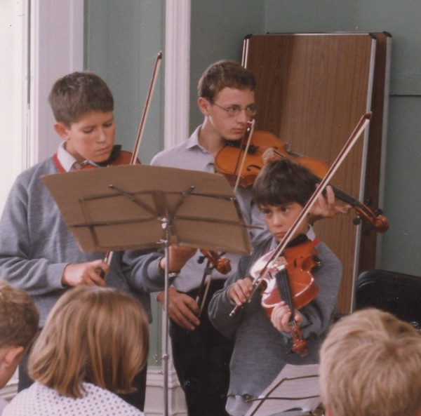 Early tastes of performing: Ned Mortimer (far right) playing before the children at Sompting Abbotts Prep School in 2002.