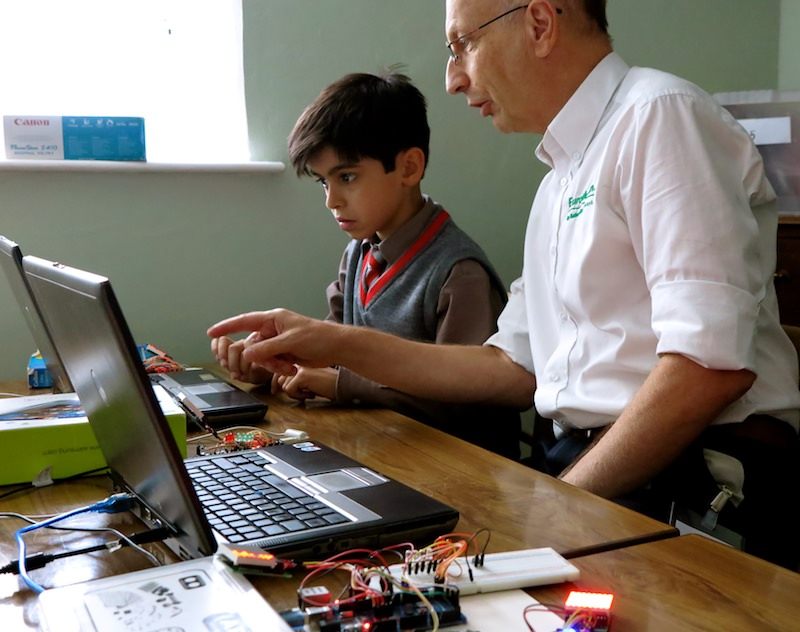 Pupil being guided in computer programming at the weekly Coding Club at Sompting Abbotts Preparatory School