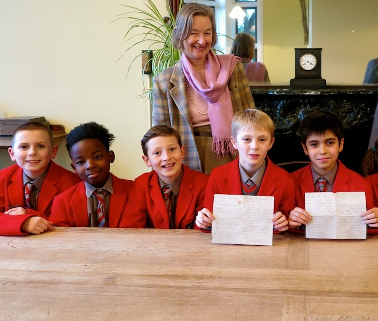 Pupils at Sompting Abbotts in 2018 with the letter from 1939 discovered beneath the school floorboards. Also pictured: Mrs Patricia Sinclair, Principal, (left) and Mr Stuart Douch, Headmaster (right)
