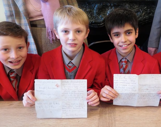Pupils at Sompting Abbotts Prep School display the letter written to a former pupil almost 80 years ago. It will now used in history lessons to help them expand on their understanding of the events of WW2