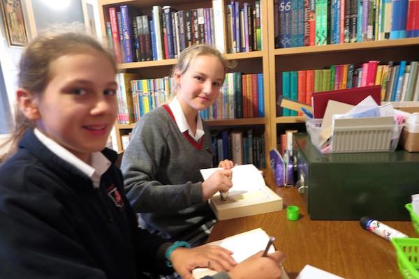 Break-time library duties underway