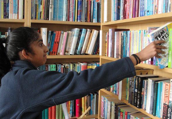 girl taking book from sompting abbotts library.JPG