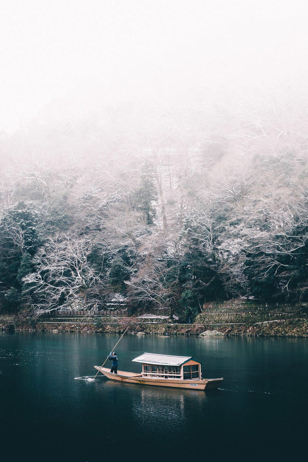 A boat on a cold winter day in Kyoto. I feel like this photo kind of changed the feel of my photos going forward. It was such a peaceful and wondrous moment, and it was at that moment that I realized that that feeling is what I wanted to achieve with my photography.  Shirahige jinja at sunrise. (See first image above)This is a shrine on the edge of Lake Biwa. There's something soothing about the torii gate sitting alone in the lake. Add in a calm, quiet morning and a clean sunrise, and you have something simply extraordinary.