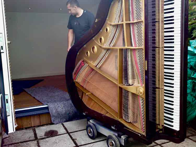 Piano arriving in the then new studio