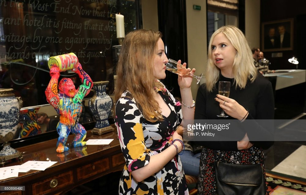 Writer Charlotte Couldrey (right) and guest with Wild Kong with Oil by Richard Orlinski