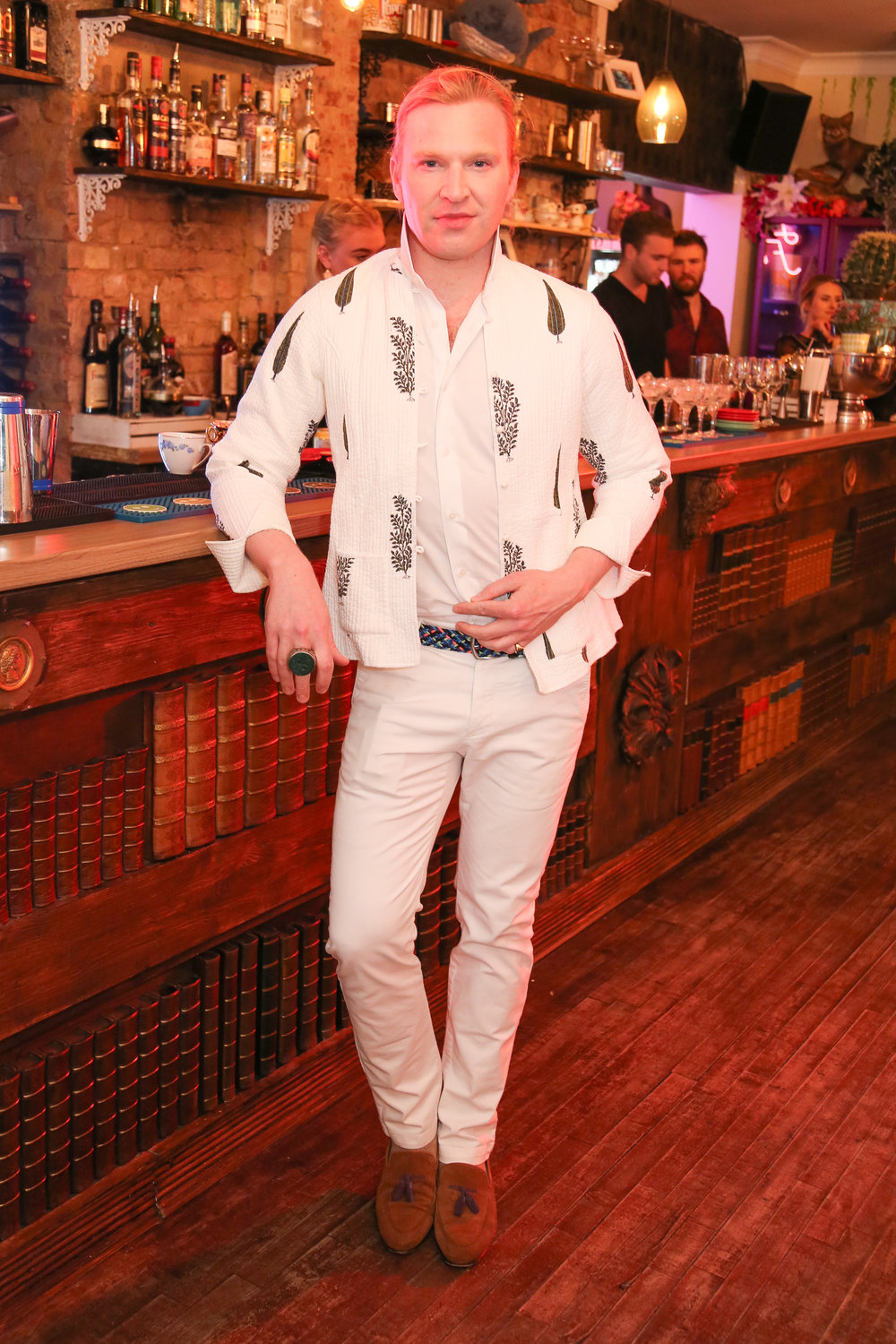 Henry Conway attends the launch of the  Little Blue Door , Fulham