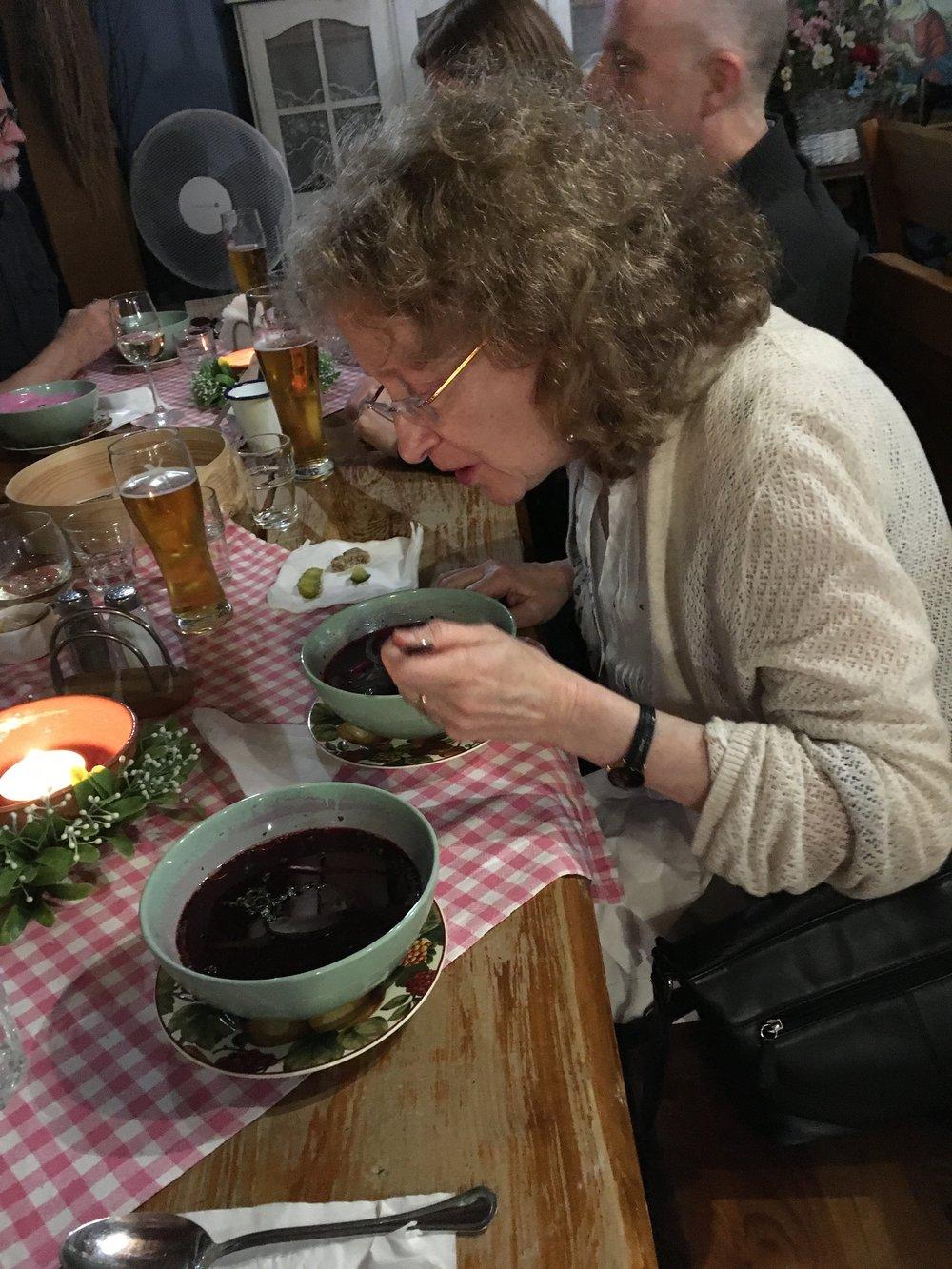 Judy eating borscht.jpg