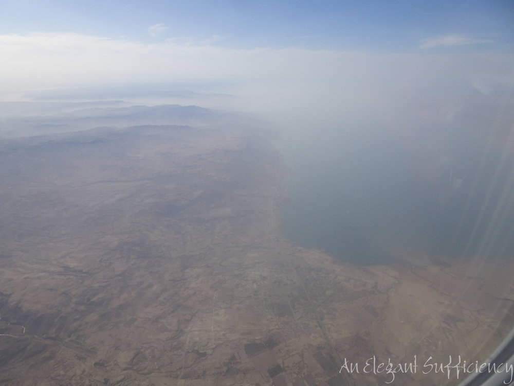 We had started the day somewhere along the Eastern side of the coastline around the centre of the picture and the muddy patch in the water almost beneath us is where the River Jordan enters the Dead Sea. (We are flying westwards)