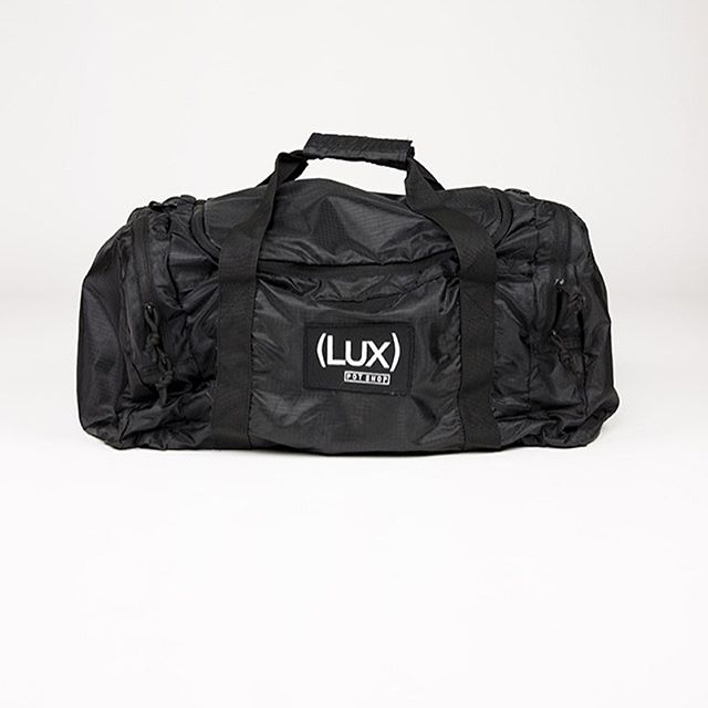 Where do you stash your stuff? Our duffel bag is durable, water resistant and packable - great as a carry-on or as an every day gym bag.
