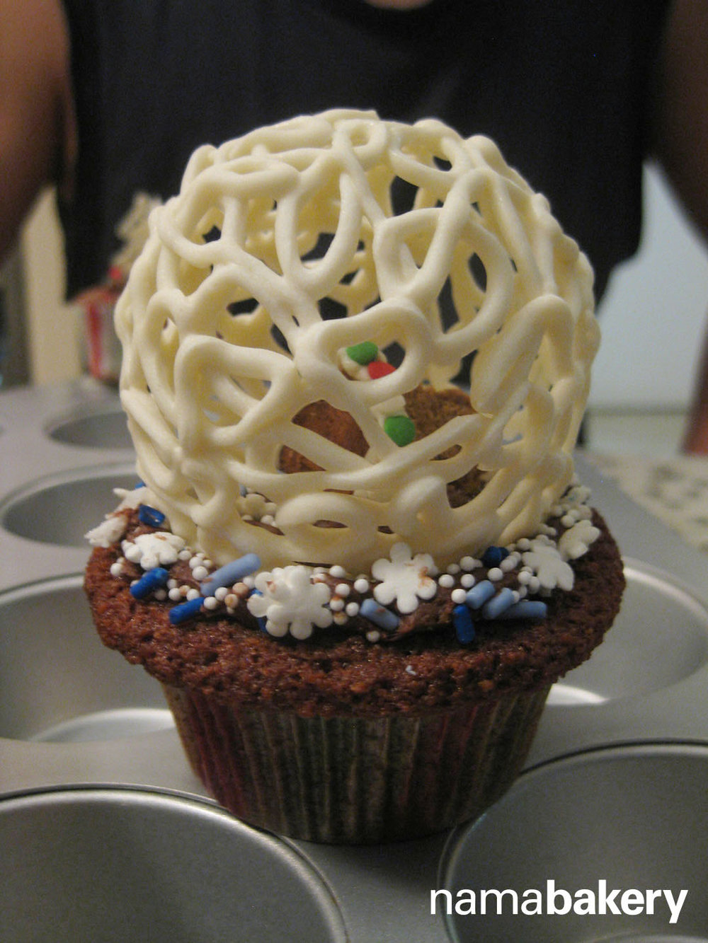 Gingerbread cupcakes with gingerbread houses inside white chocolate globes. Grand Prize Winner of the iHeartRadio Cookoff/Bakeoff in 2013.