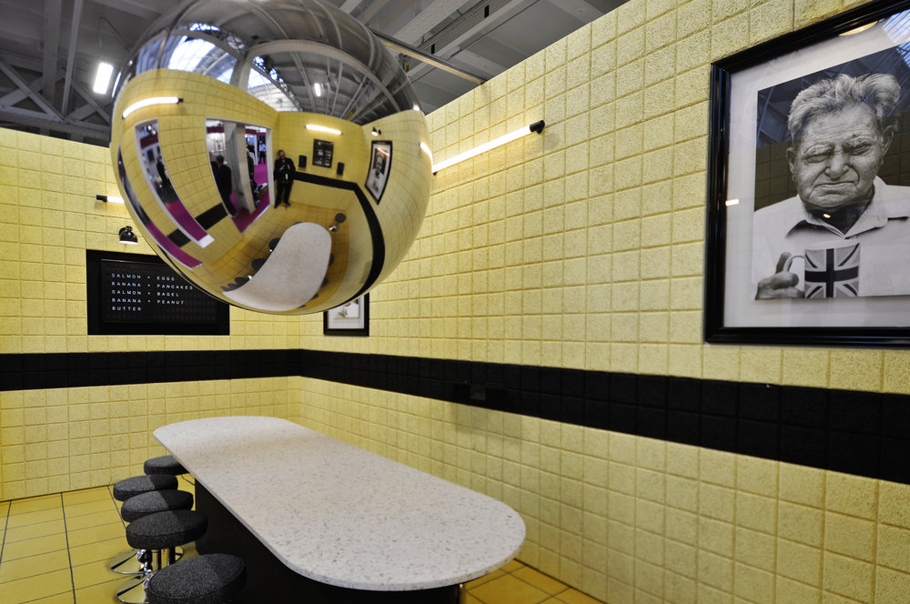 SLEEP+EAT_ ANTICAFF - BRIEF: To design an exhibition set based around the word 'Cafe' that is familiar but new.IDEA: To rethink what a traditional British Cafe is and what it means today if you take away the food and drink.OUTCOME: An uncomfortably familiar play on the traditional British Caff. A communal, abstract space for everyone. A space to socialise and be sociable without relying on social media.