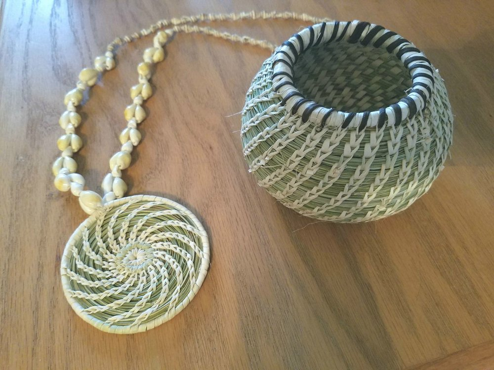 On the left is a beautiful necklace that I purchased from Terrol Dew Johnson. On the right you can see my finished basket. It was so much fun and exciting to experience how the shape formed in my hands during work.