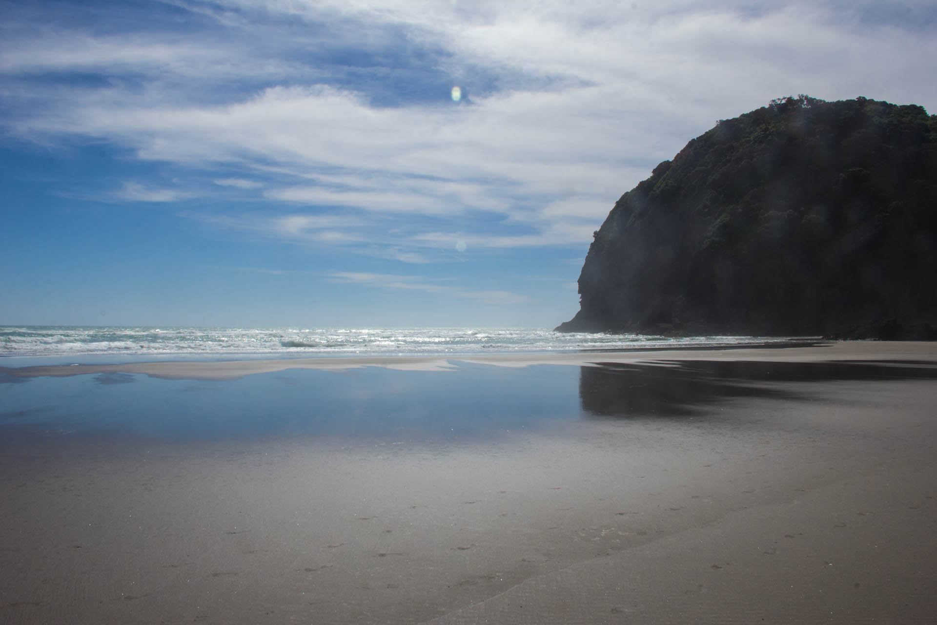 north end of piha beach sun and sand new zealand