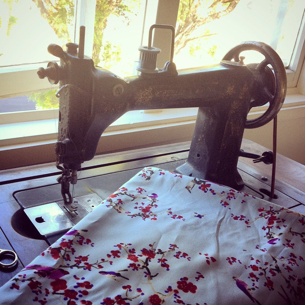treadle sewing machine with blossom fabric for sun cover