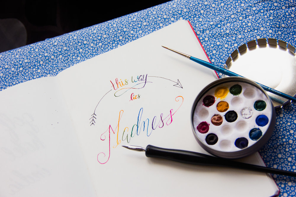 rainbow this way lies madness calligraphy lettered quote