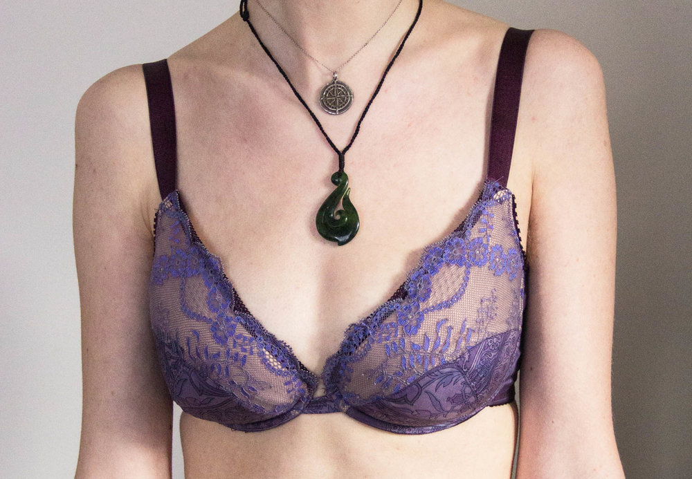 front of purple partial band bra