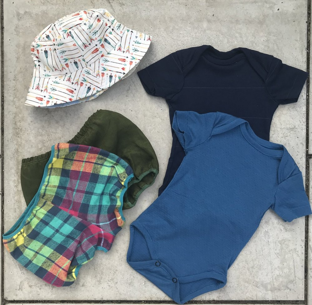 handmade baby clothes flatlay