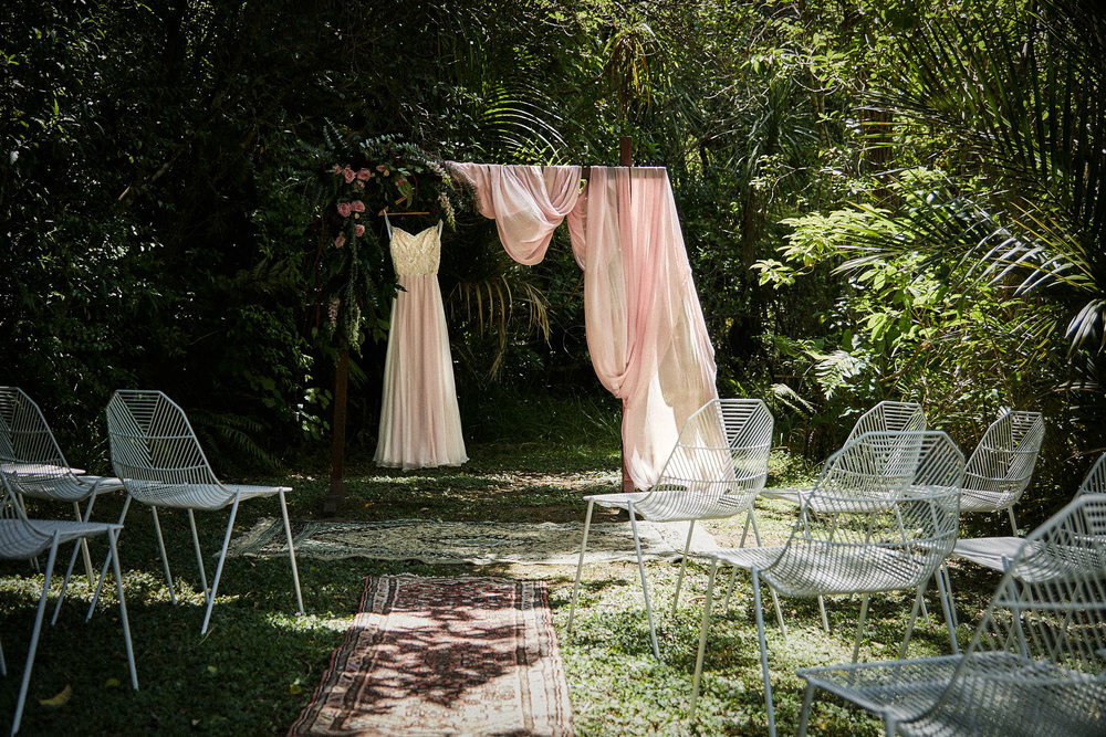 wedding dress and arch