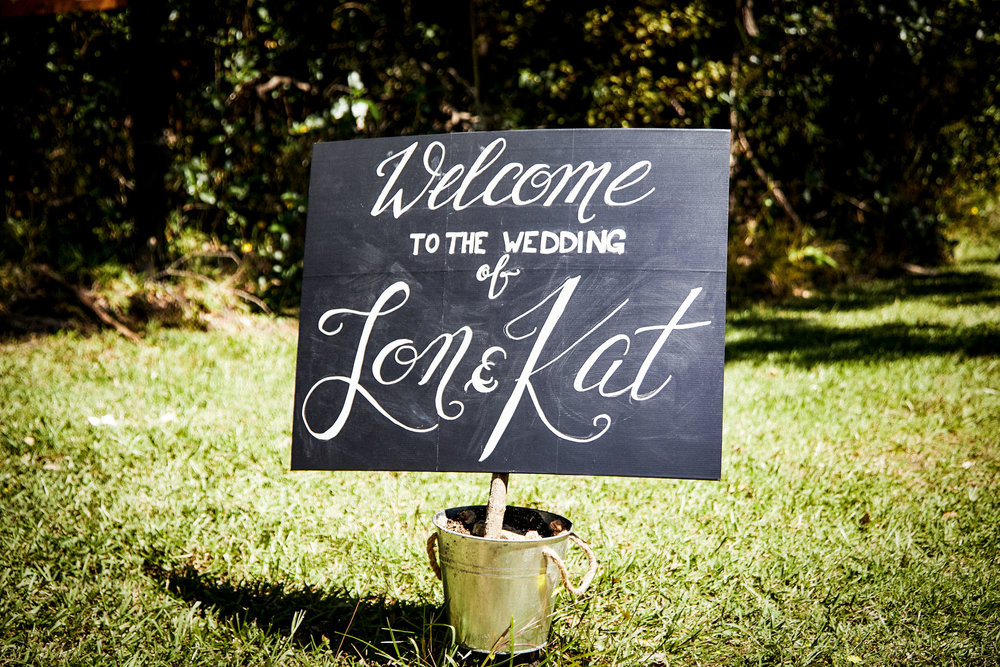 welcome to the wedding sign hand lettered