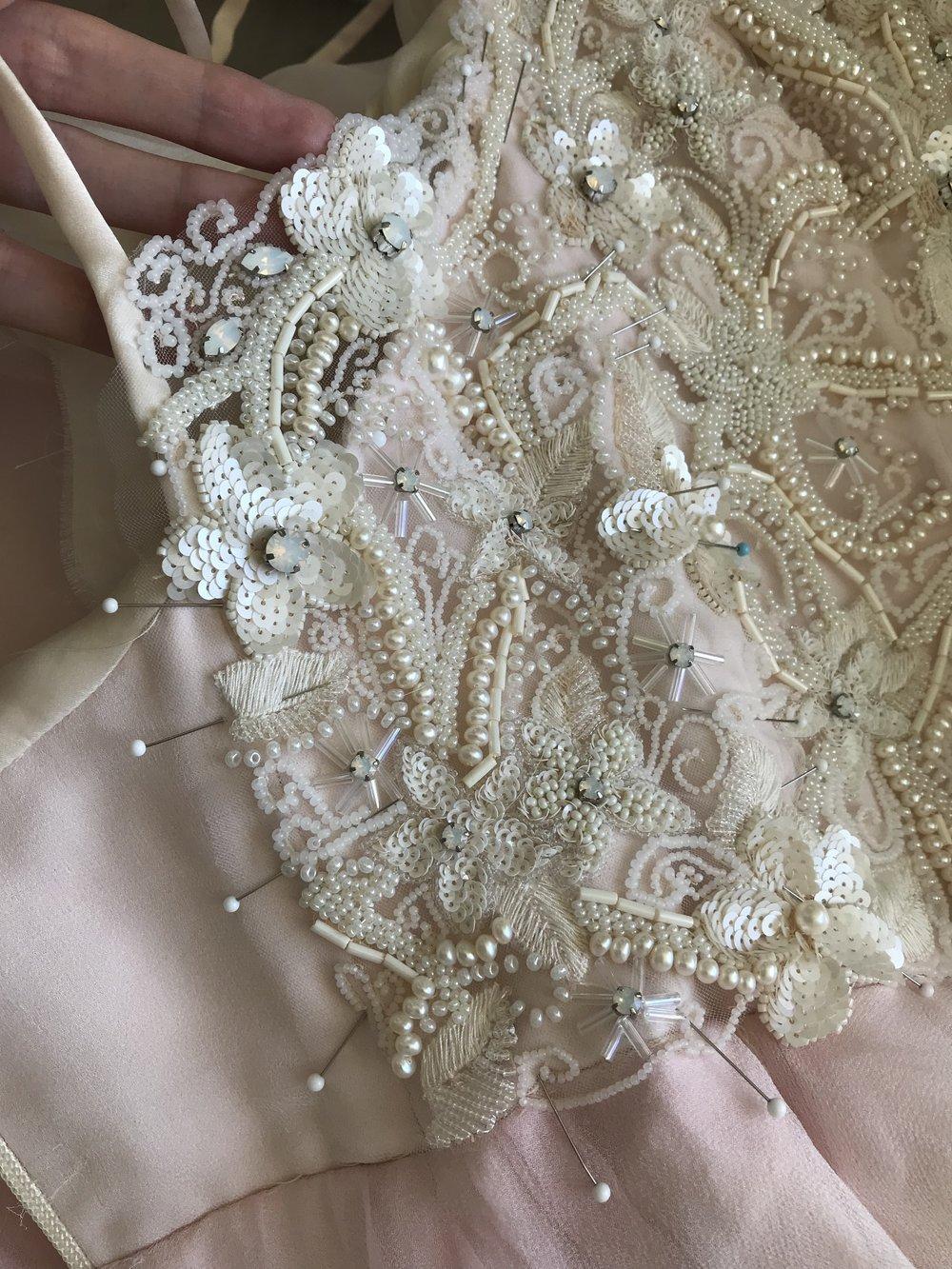 sewing sheer overlay to wedding dress