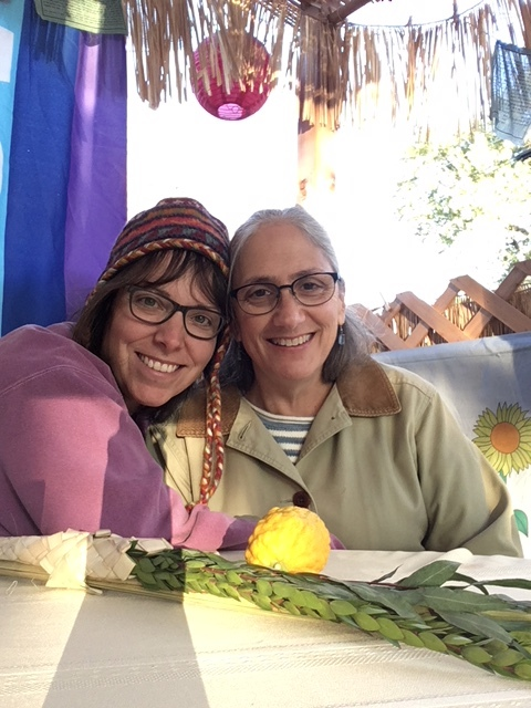 Amy and her wife Liddy in their Sukkah