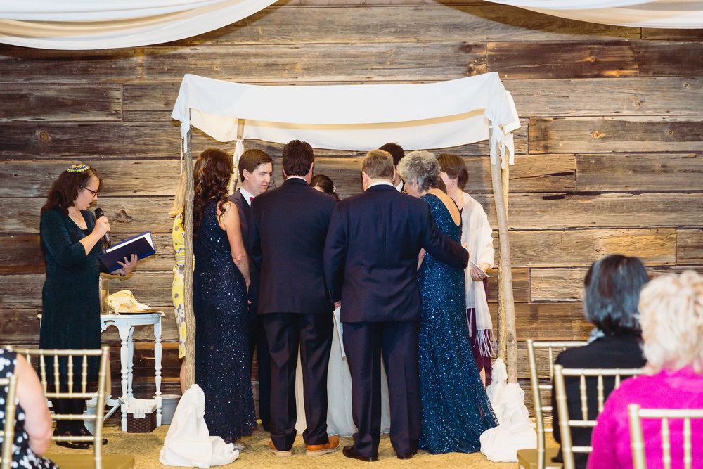 Blessings under the  chuppah  (wedding canopy) .  Photos by Allie with  Heartwild Photography
