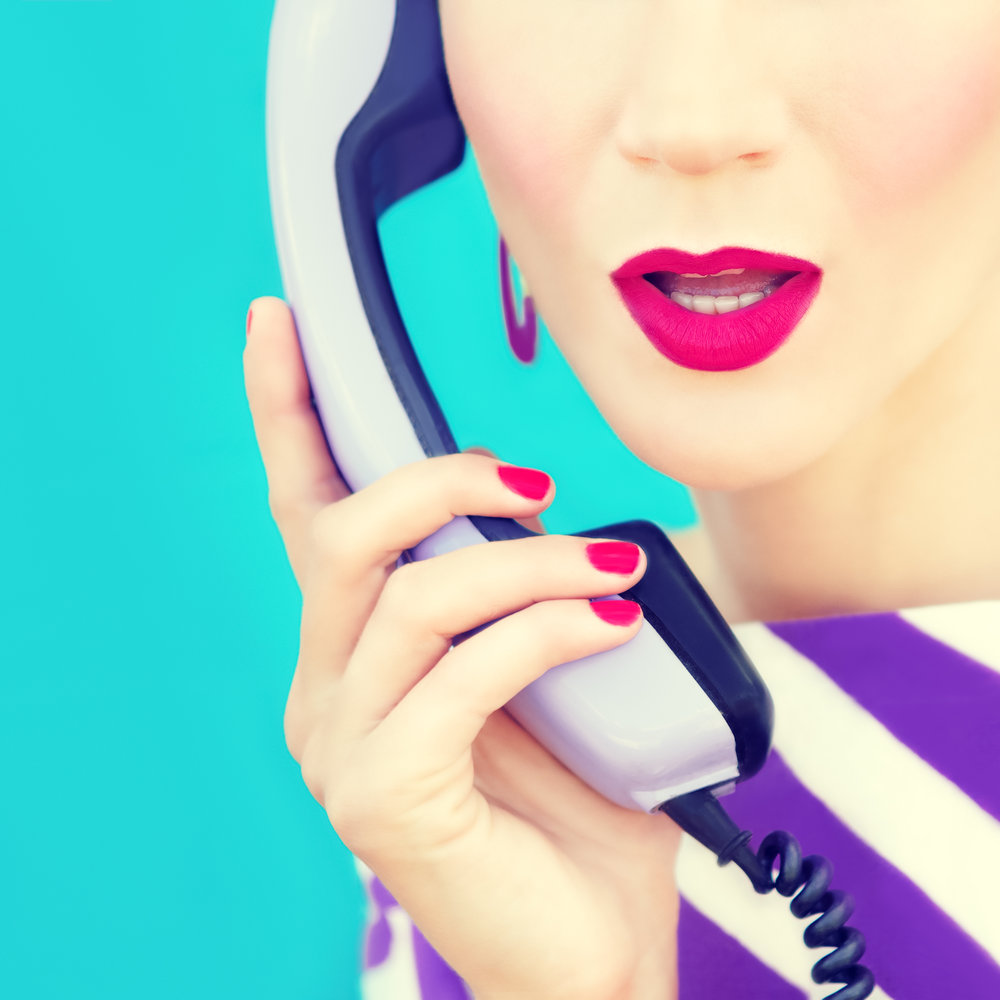close-up-portrait-of-a-retro-girl-with-telephone-PWDUE53.jpg