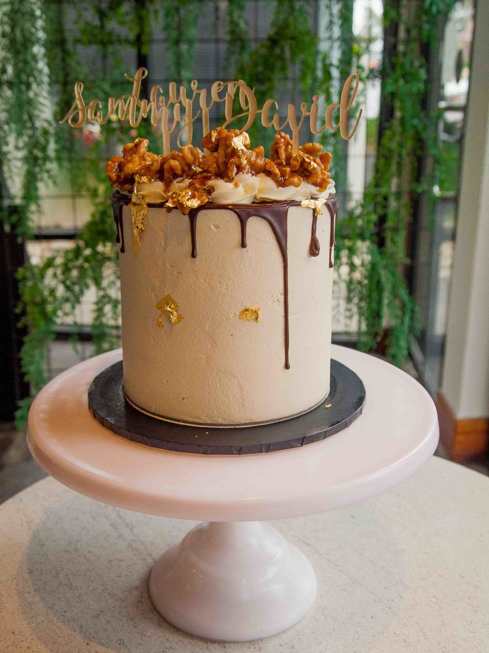 Walnut, Maple Syrup and Coffee - Dark chocolate and coffee cake filled with layers of maple syrup and cinnamon frosting and salted walnuts. Decorated with maple syrup frosting and salted caramel walnuts.5