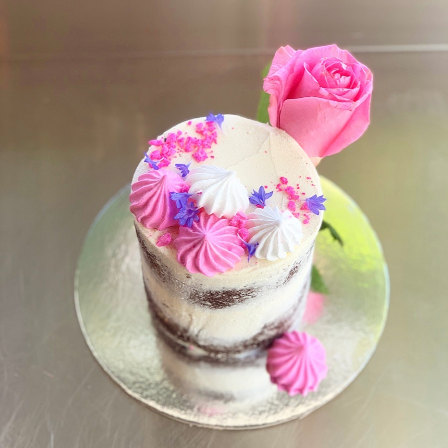 Valentines Cake - Semi nude frosting with meringues, gold cake topper, and garnished with a roseFlavour options:Elderflower & RaspberryChocolate & Spiced Rum CaramelServes 2 people = $40.00