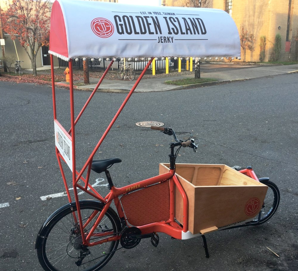 "VENDING BIKES One of our clients needed a little easier way to get the jerky to the people.  Introducing what we are nearly positive is the world's first zero-carbon beef-jerky delivery vehicle.  She's named ""Pepper"" We were sad to see her go."