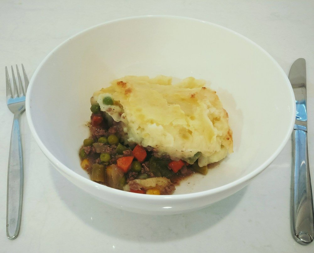 Cottage Pie - Ingredients300g Prime beef mince1 onion - diced1 tbsp soy sauce*1 tbsp worchestershire sauce*1 onion soup mix500g frozen mixed veges500g potatoes - mashedGrated cheese (optional)*If you don't already have worchestershire sauce or soy sauce you can add a maggi cottage pie mix to add more flavour, just boil the mince and onion and add the cottage pie packet towards the end.Method1. In a saucepan boil the mince, onion, soy sauce and worchestershire sauce in water, cover – add enough water to cover the mince, the longer you can let it simmer, the more flavour it will have but for at least an hour.2. Mix the onion soup through the cooked mince to thicken it, let simmer for a few minutes to thicken stirring to make sure it doesn't stick3. Add the frozen mixed veges to the mince and stir to cook though4. Pour mince and vege mix into an oven proof dish and top with mashed potatoes and cheese if using, brown the top in the oven and serve