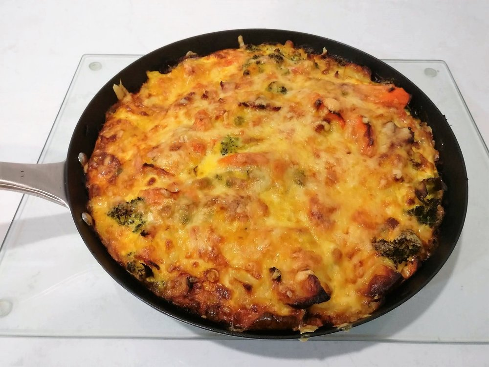 Bacon and Vegetable Frittata - Ingredients200g Bacon – chopped1 Onion – choppedCooked vegetables5 eggs – whisked with ¼c milkCreamed corn – 1 canGrated cheeseMethod1. Brown the bacon and onion together in a large frying pan2. Add leftover cooked vegetables, cook until heated though3. Pour bacon, onion and vegetables into an oven proof dish4. Cover with whisked eggs and milk5. Add can of creamed corn and mix though6. Top with grated cheese7. Cook in the oven at 180 until golden brown