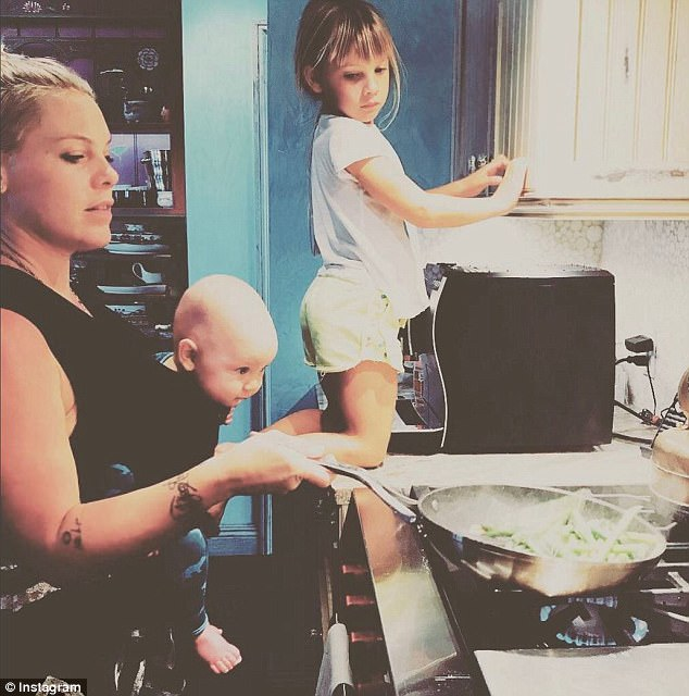 Pink gets slammed  - Pink posted this photo on instagram and has been slammed with comments about her son being in danger as he is close to the stove.We have all been there!! What mum hasn't struggled her way though the late afternoon - early evening witching hour when your baby is unsettled and wants to be held, but you also have to get dinner on the table as quickly as possible to avoid the wheels completely falling off.I don't look at this photo and see a baby in danger, i see a mum doing her best to get food on the table and ensure her kids are happy aswell. I think its brilliant that shes taking the time to make a home cooked meal and look how interested both of her kids are - monkey see, monkey do. Great skills being passed on to the next generation!!!I cook most nights with my 1 year old daughter on my hip, all she wants is to be held and its always when i'm cooking dinner.I'm sure Pink thought about the danger of carrying Jameson in the front pack while standing at the stove, i'm also sure that every mum is subconsciously thinking about the safety of her children in all situations, it just our instinct.Part of the reason i did the $100 challenge was to show how easy it is to whip up a dinner meal, with a baby on your hip if needed and for those really tough evenings you can pull a meal out of the freezer and get it on the table with little fuss :)And hey, if Pink can do it, so can all of you ;)