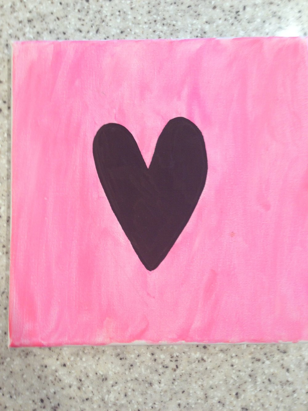 Heart Canvas - Instructions1. Cut out a cardboard or paper shape (heart)2. Stick it to the canvas with double sided tape3. Paint the area around the shape 4. Pull off the shape, can paint or color it in if you like as i have done in black