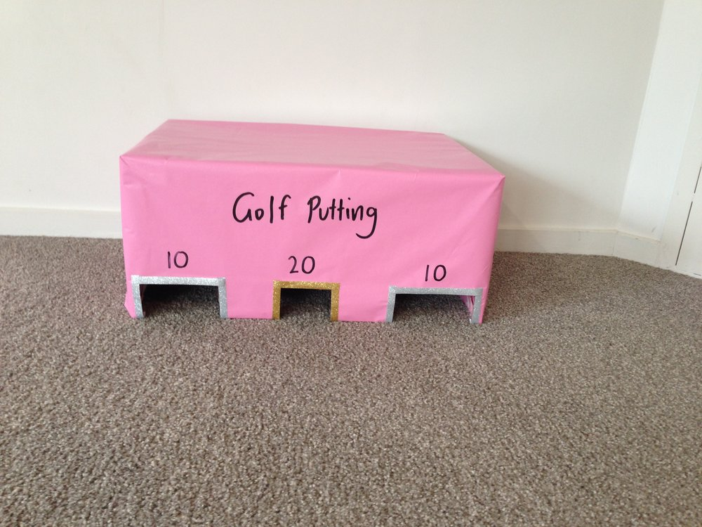 Golf putting - Instructions1. Cover a cardboard box in wrapping paper2. Cut out 3 square gaps in the bottom3. Label numbers above the gaps for different points when the ball goes through4. Decorate it however you like**Doesn't need to be used for golf putting, could be rolling a small ball or marble