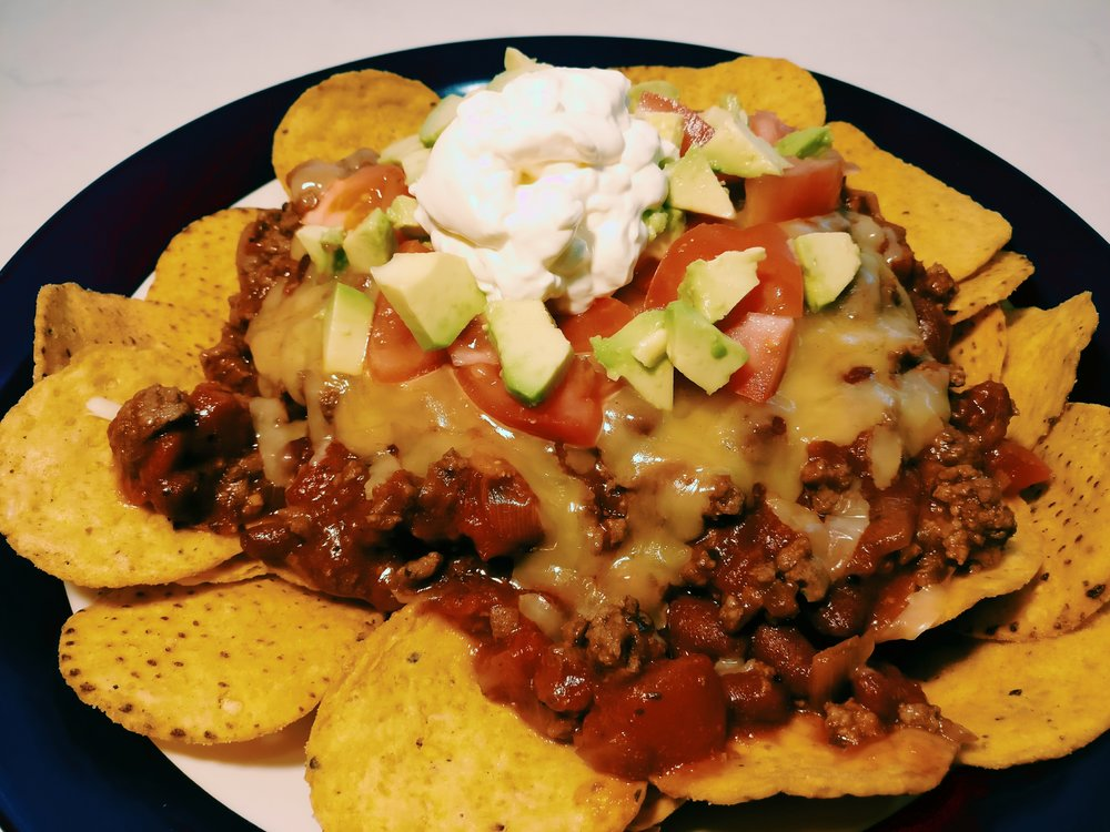 Loaded Nachos - Ingredients300g Beef Mince1/2 Onion - Diced1 Can - Diced Tomatoes1/2 can - Chlli Beans2T Taco/Burrito Spice Mix (or to taste)1/4C Water1-2 bags - Corn Chips1/2C Grated Cheese125g Sour Cream1/2 Tomato - Diced1/2 Avocado - DicedMethod1. Brown the mince and onion in a large frying pan2. Add the tinned tomatoes, chilli beans, taco spice mix and water to the frying pan3. Simmer for 10-15 minutes until the sauce is at the desired consistency4. Serve the mince mixture on top of corn chips, top with the grated cheese, diced tomato, diced avocado and sour cream