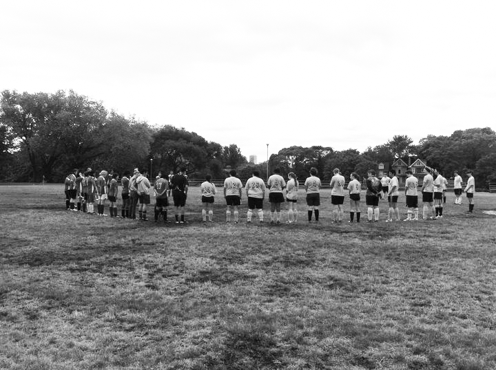 Gathering for a moment of silence on the Withrow pitch in 2011 to remember Pink Turfer Karin Lapins, who died of cancer