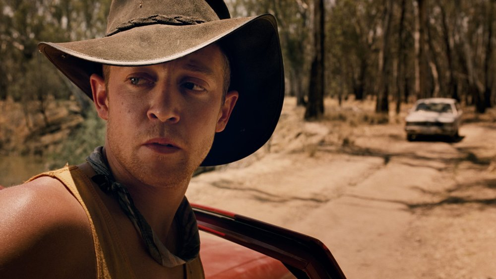 Nice Shootin Cowboy - Ben Phelps/John Maynard - Drama - 2008A John Maynard production, and directed by Ben Phelps (Checkpoint), Nice Shootin' Cowboy is a tough portrayal of the misplacement of trust set in the Outback of Australia.The Score is a very minimalist combination of Blues Harp and Electric Guitar (Jon Pease). As the film is a stylised Western, the score lightly borrows from the genre. More Info