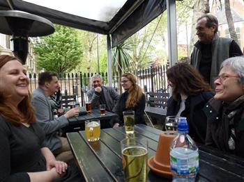 At the pub. Some of the International ACME 2012 Crew, Lea O'Lochlan, Manager (left), David Stanton, Director (standing), Hélène Lord (Québec artist), photo: Erica Seccombe