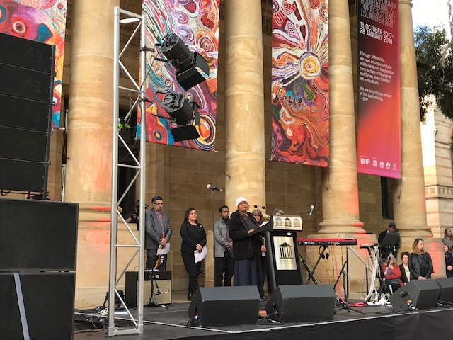 Ku Arts Anangu Mayatja, Alison Milyika Carroll, gives an opening address in Pitjantjatjara language at the opening of TARNANTHI Festival of Contemporary Aboriginal and Torres Strait Islander Art, Art Gallery of South Australia, 2017. Photo: Ku Arts