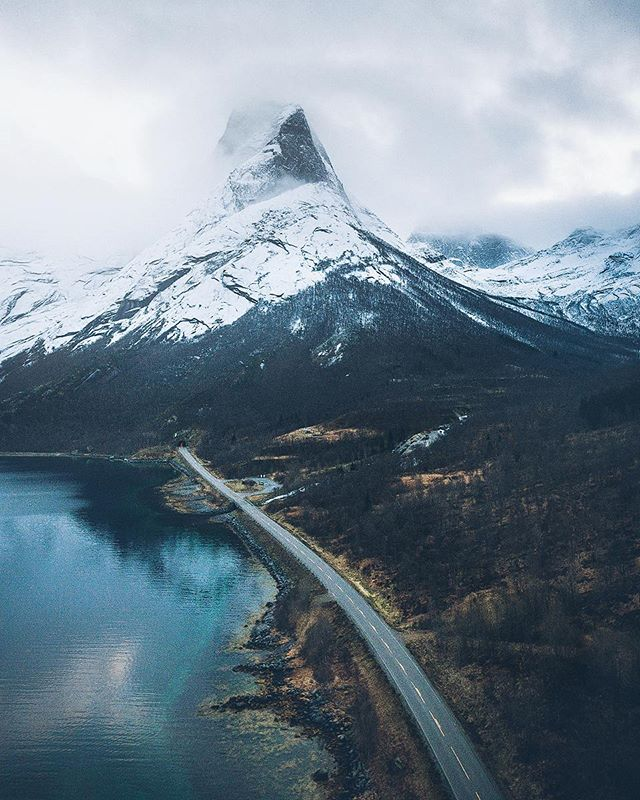 Stetind, the Norwegian national mountain. 1392 masl 🇳🇴 On the road with @renaultnorge #passionforlife  #fromwhereidrone #beautifuldestinations #artofvisuals #thisweekoninstagram #wildernessculture #discoverearth , , , #main_vision #mountainstones #ourplanetdaily #greatnorthcollective #visualcreators #thelensbible #stjørdalfoto #mobilemag #earthfocus #bewild #modernoutdoors #MoodyGrams #folkscenery #AGameofTones #visualsoflife #earth #travelpassport #aerialphotography