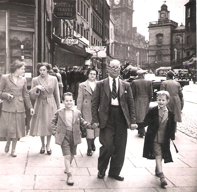 My grandfather John McGhee, walking down Leith Walk in Edinburgh, with my brothers Alan and James; granny Helen is just behind.