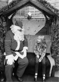 Black and white Father Christmas with child